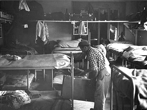 Stanza in cui nel 1962 vivevano alcuni immigrati italiani a Ginevra.